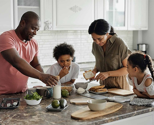 Family members making a healthy lunch together